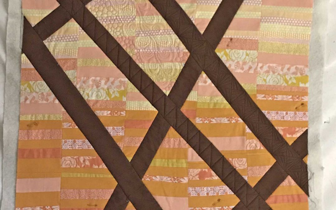 Break through the fence quilt top